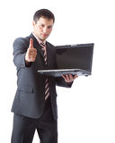 Businessman wit laptop Stock Photos