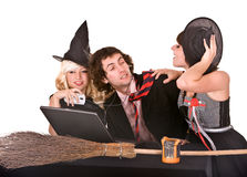 Businessman, witch girl, laptop,broom in office Royalty Free Stock Images
