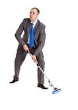 Businessman With A Mop Royalty Free Stock Photos