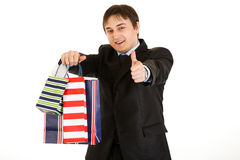 Free Businessman With Bags And Showing Thumb Up Gesture Royalty Free Stock Photo - 17493605