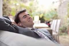 Businessman With Earphones Relaxing At Home Royalty Free Stock Photo