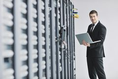 Businessman With Laptop In Network Server Room Stock Image