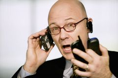 Free Businessman With Multiple Cell Phones Royalty Free Stock Photo - 4611985