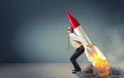 Free Businessman With Rocket On His Back Ready To Take Off Stock Image - 195920321