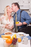 Businessman With Wife In Kitchen Stock Image