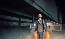 Businessman With Wings And Rockets Royalty Free Stock Image