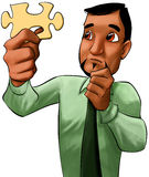 Businessman witha a piece from a puzzle Stock Photos