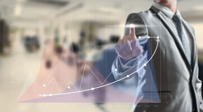 Businessman woking on high growth graph Royalty Free Stock Image
