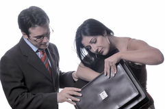 Businessman and woman with bag. Businessman and businesswoman, with woman looking inside briefcase; isolated on white background Royalty Free Stock Photography