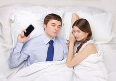 Businessman and woman in bed Royalty Free Stock Photos