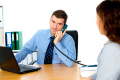Businessman and a woman in counseling. Business men and a women in counseling interview royalty free stock photo