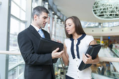 Businessman and woman discussing work Royalty Free Stock Photo