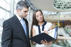 Businessman and woman discussing work Stock Photo