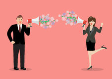 Businessman and woman are holding a megaphone with flowers Stock Image