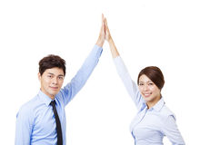Businessman and woman joining hands and cooperation concept Royalty Free Stock Images