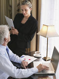 Businessman And Woman With Laptop And Documents Royalty Free Stock Images