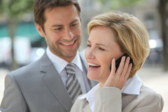 Businessman and woman laughing Stock Photo