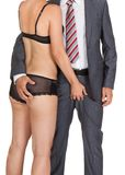 Businessman with woman in lingerie Royalty Free Stock Photography