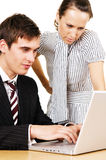 Businessman and woman looking in to the laptop Stock Images
