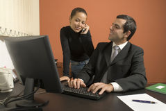 Businessman and Woman in Office - Horizontal Stock Photos