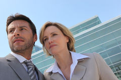 Businessman and woman outside. Royalty Free Stock Images