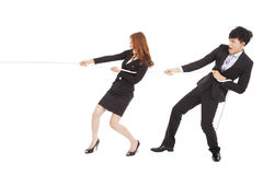 Businessman and woman playing tug of  war Stock Photography