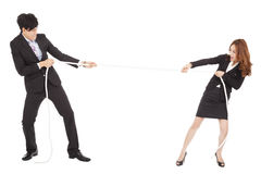 Businessman and woman playing tug of  war Royalty Free Stock Image