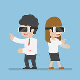 Businessman and woman playing with vr glasses Stock Image