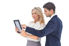 Businessman and woman pointing something on digital tablet Royalty Free Stock Photos