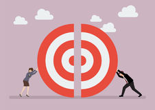 Businessman and woman pushing a pieces of big target together Royalty Free Stock Photo