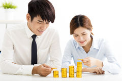 Businessman and woman Put Coins To Stack Of Coins Royalty Free Stock Photo
