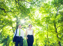 Businessman and Woman Relaxing Outdoors Royalty Free Stock Photos