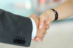 Businessman and woman shake hands as hello in office closeup Royalty Free Stock Photos
