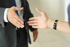Businessman and woman shake hands as hello in office closeup Stock Image