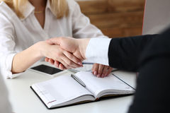 Businessman and woman shake hands as hello in office Royalty Free Stock Photo