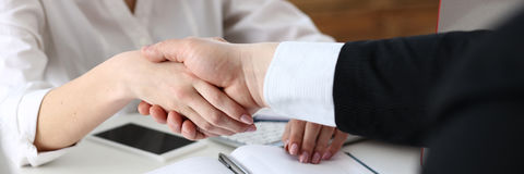 Businessman and woman shake hands as hello in office Royalty Free Stock Image
