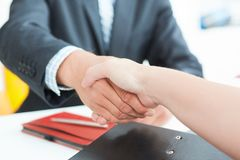 Arms of businessman and woman shaking hands as hello in office closeup. Friend welcome, introduction, greet or thanks. Businessman and woman shake hands as hello royalty free stock photos