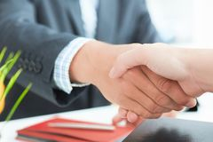 Arms of businessman and woman shaking hands as hello in office closeup. Friend welcome, introduction, greet or thanks. Businessman and woman shake hands as hello stock photo