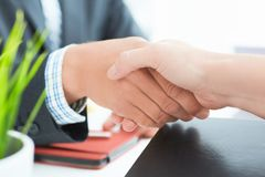 Arms of businessman and woman shaking hands as hello in office closeup. Friend welcome, introduction, greet or thanks. Businessman and woman shake hands as hello royalty free stock photo