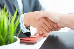 Arms of businessman and woman shaking hands as hello in office closeup. Friend welcome, introduction, greet or thanks Stock Image