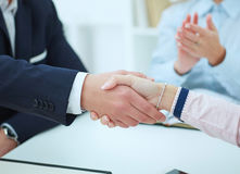 Businessman and woman shake hands as hello in office closeup. Royalty Free Stock Photos