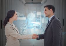 Businessman and woman shaking hands each other in office corridor. Digital composition of businessman and women shaking hands each other in office corridor Royalty Free Stock Photos