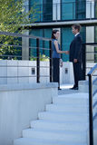 Businessman and woman shaking hands outside building Royalty Free Stock Photo