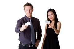 Businessman and woman showing. Businessman in formal suit and woman in dress showing business card Stock Images