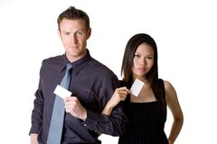 Businessman and woman showing blank bussiness car stock photography