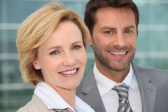 Businessman and woman smiling Stock Photo