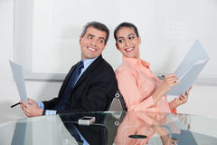 Businessman and woman spying Stock Photo