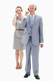 Businessman with a woman talking in background Stock Photos