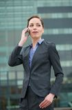Businessman woman talking on mobile phone out of the office Stock Photo