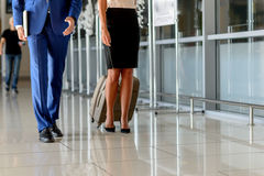 Businessman and woman traveling on official journey Royalty Free Stock Photo